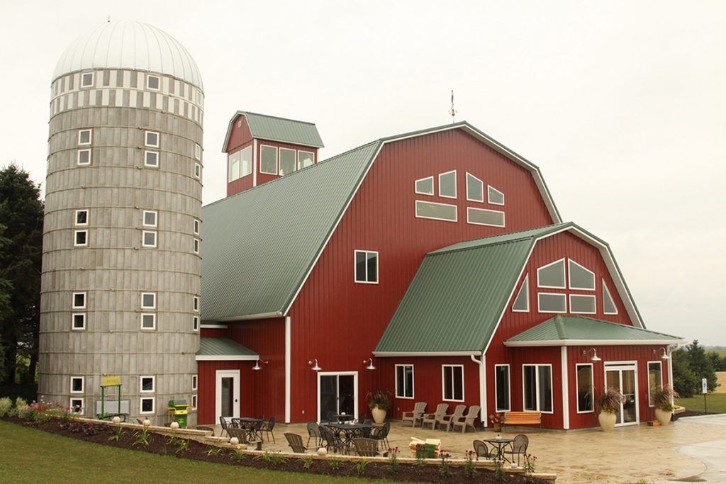 large red barn with silo